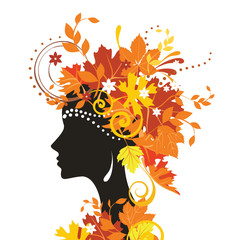 Decorative silhouette of woman with autumn leaves