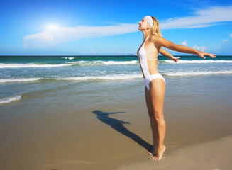 Young woman enjoy sun near ocean