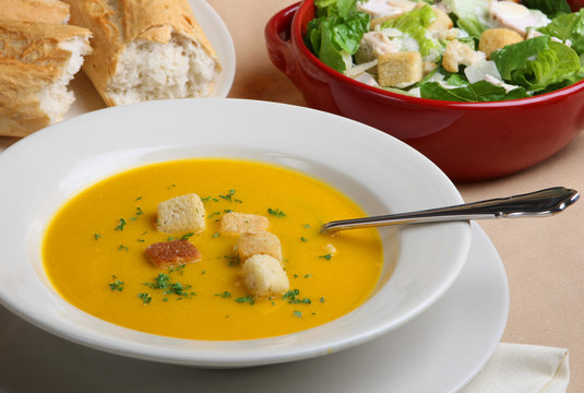 Pumpkin soup with Caesar salad and crusty bread
