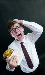 Screaming funny businessman with gift box