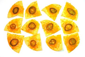 A dozen nachos isolated on white background.