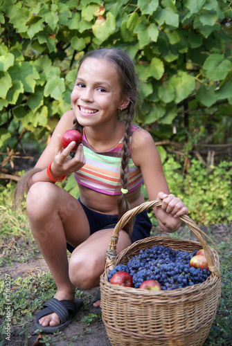 """Preteen Girl With Basket Full Of Organic Grapes And"