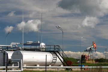 Oil pump and storage tanks