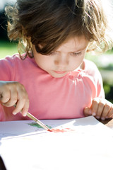 drawing little girl with brush