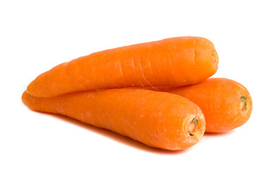 Three carrots isolated over white background