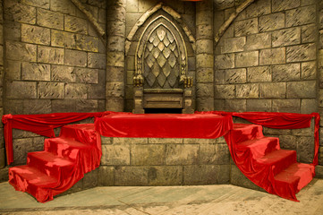 Empty middle-age royal throne with red velvet