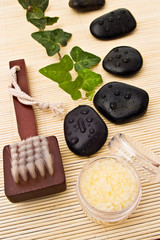 spa arrangement with leaves stones brush and sea salt