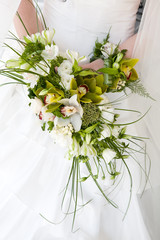 bouquet with orchids in the hands of the bride