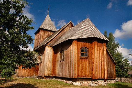 Wooden old styled church in polish countryside