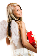smiling beautiful blond angel with a gift on white background