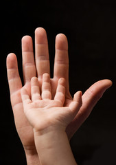 mens and childs palm together