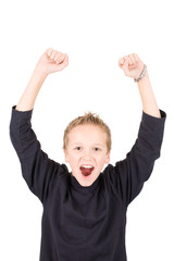 portrait of an excited young boy with raised hands