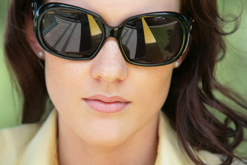close-up portrait of the girl in sunglasses