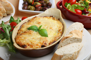 Lasagna with Italian salad and a crusty baguette
