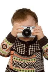 little boy taking a photograph
