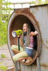 Beauty girl sit in the ring and singing to megaphone