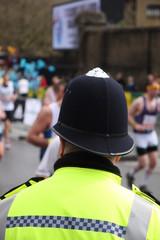 Policeman watches the London Marathon