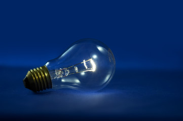 Blue background with lightbulb