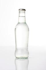 Bottled water shot in studio, isolated on white