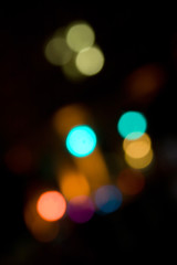An abstract bokeh background with blurred light blobs.