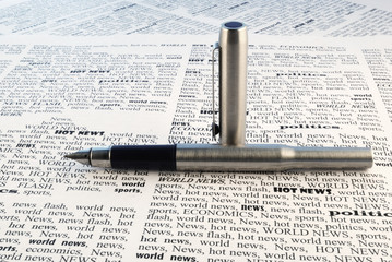 we take all news, fountain-pen above a newspaper closeup