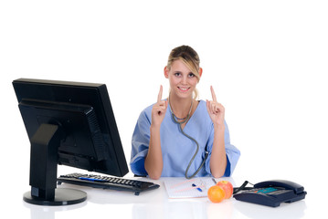 Attractive female doctor pointing to apple and orange, fruit,