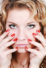 Face girls with bright eyes and red nails