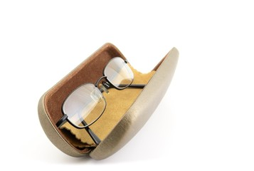 Pair of black rimmed metal spectacles in case