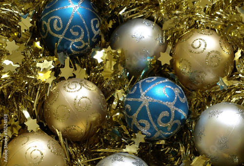 blue and gold christmas decorations on gold tinsel background
