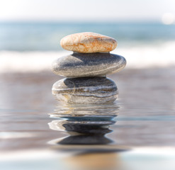Stack of pebbles on sea background