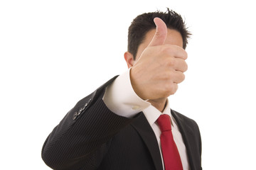 A business man giving the thumb-up sign (focus on the hand)