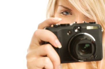 Beautiful smiling woman with digital camera