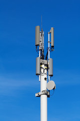 Tower with cellular antennas and sky at the background