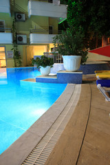 Part of blue swimming pool in the evening.