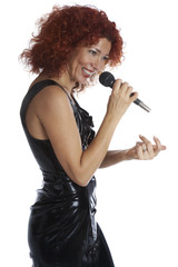 The red-haired singer in a black dress