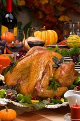 Garnished roasted turkey on holiday decorated table