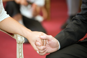 man and woman hands at wedding ceremony