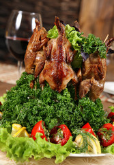 Fried quail carcase with vegetable tomato and wine