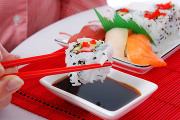 Set of rolls and sushi on several plates