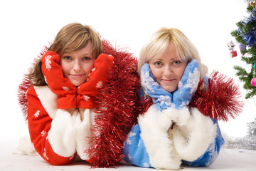 two women in christmas costumes. Isolated on white.