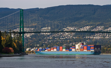 Large container ship   under the Lions Gate  Bridge