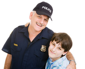Friendly police officer and an adolescent boy.  Isolated