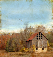 Abandoned barn in rural America on a grunge background.