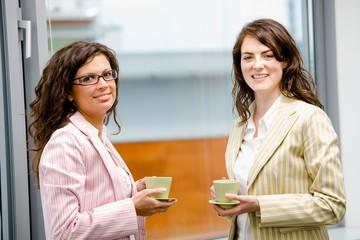 Happy young businesswomen having break at office