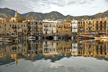 Fotobehang Cyprus girne harbor with boats and houses and reflection