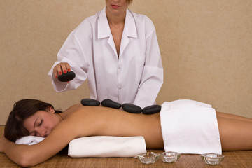 lastone massage concept with a beautiful woman at the spa