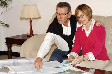 Couple trying to decide how to spend retirement money.