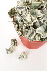 Dollars in Red Garbage Can with White Background