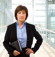Portrait of senior businesswoman at office lobby.