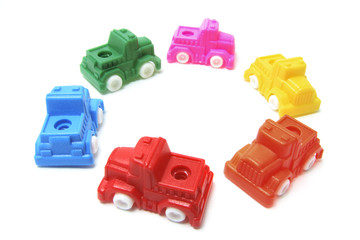 Plastic Toy Cars Arranged in Circle on White Background